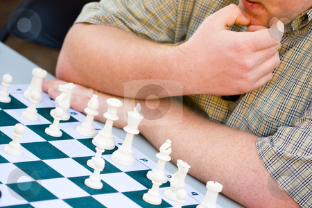 Chess competition stock photo, Young man playing chess with full concentration by Hieng Ling Tie