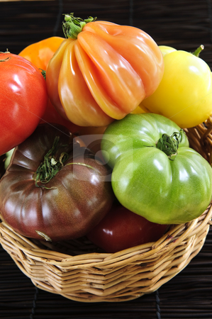 Heirloom tomatoes stock photo, Wicker basket full of multi colored heirloom tomatoes by Elena Elisseeva