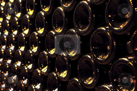 Wine bottles stock photo, Large stack of wine bottle bottoms in winery by Elena Elisseeva