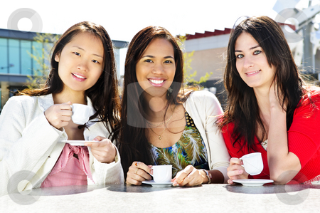 Group of girlfriends having coffee stock photo, Group of girl friends sitting and having drinks at outdoor cafe by Elena Elisseeva