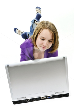 Girl with computer stock photo, Young girl lying down with laptop computer by Elena Elisseeva