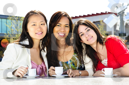 Girlfriends having coffee stock photo, Three girl friends sitting and having drinks at outdoor mall by Elena Elisseeva