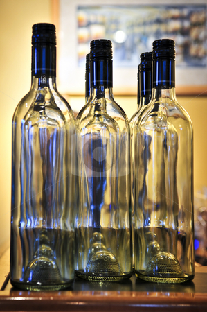 Wine bottles stock photo, Empty clear wine bottles with blue caps by Elena Elisseeva