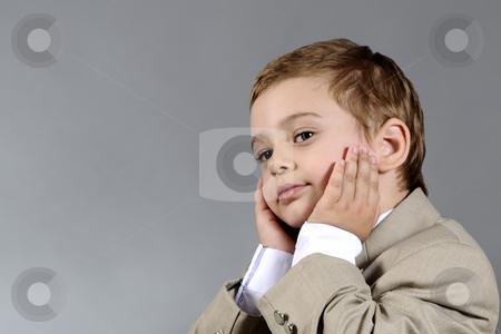 Upset boy stock photo, Portrait of upset little boy by Dragos Iliescu