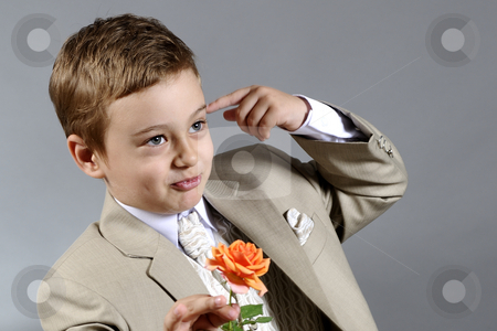 Boy and flower stock photo, Portrait of elegant boy preparing to offer an orange rose by Dragos Iliescu