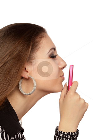 Attractive woman kissing her mobile phone stock photo, Attractive woman kissing her mobile phone over white by Ivelin Radkov