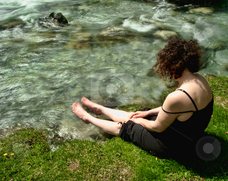 Relaxing time stock photo, Woman dipping her toes in a clear mountain stream by Laurent Dambies