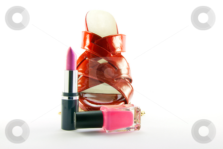 Red Shoe with Lipstick and Nail Polish stock photo, Single red shoe with pink lipstick and nail polish with clipping path on a white background by Keith Wilson