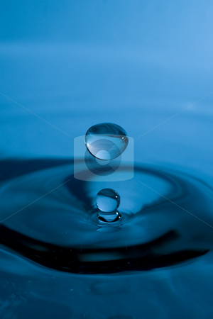 Drop of Water stock photo, Drop of water bouncing back up after hitting the surface of the water by Inge Schepers