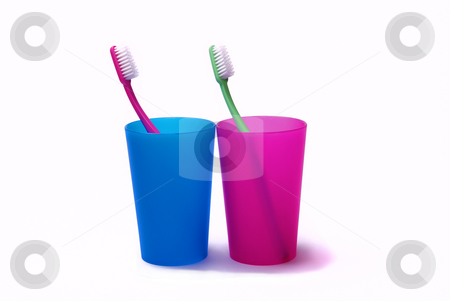 Toothbrushes in color holders stock photo, Toothbrushes in color holders by Roman Kalashnikov