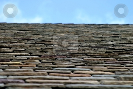 Roof Top stock photo, Close up of roof tiles with blue sky in background. by Henrik Lehnerer