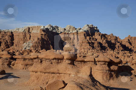 Goblin Valley stock photo, View of red rock formations in San Rafael Swell,Goblin Valley with blue sky by Mark Smith