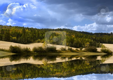 Summer Storm stock photo, Storm in the mountains with reflections on water by Mark Smith