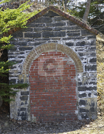 Bricked in? stock photo, A small arched entryway in a stone building that has been bricked in. by Tom Weatherhead