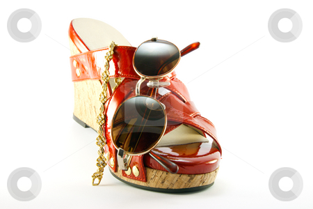 Red Shoe with Sunglasses and Bracelet stock photo, Single red shoe with brown sunglasses and gold bracelet with clipping path on a white background by Keith Wilson