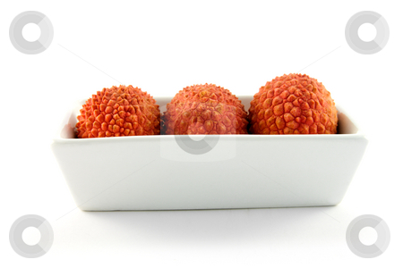 Three Lychee in a Dish stock photo, Three lychee in a dish with clipping on a white background by Keith Wilson