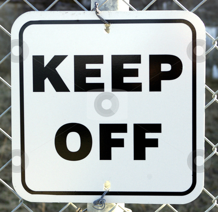 Keep Off stock photo, A warning sign on a fence telling people to Keep Off. by Tom Weatherhead