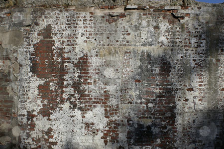 Weathered Brick Wall stock photo, An old brick wall background that has been well weathered from many years of neglect. by Tom Weatherhead