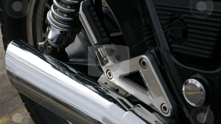 Motorcycle Exhaust stock photo, A close up of a motorcycle exhaust and rear peg. by Tom Weatherhead