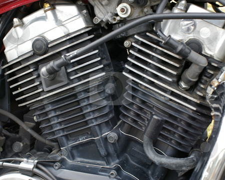 Motorcycle Engine stock photo, A closeup of a motorcycle engine showing cylinder heads and plug wires. by Tom Weatherhead