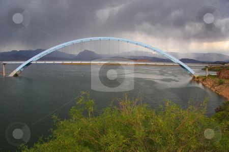 Bridge Rosvelt Dam stock photo, Arch Bridge with stormy skys by Mark Smith