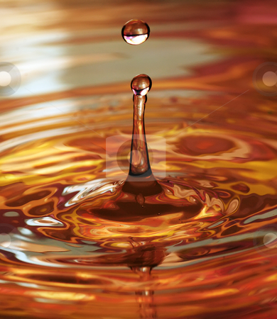 Colourful water drop stock photo, A drop of water by Paul Turner