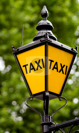 Taxi post with clipping path stock photo, Taxi post on green background with clipping path by Gabriele Mesaglio