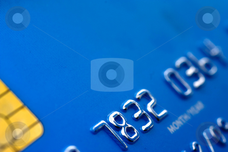 Blue credit card stock photo, Close up of blue credit card with partial code and security microchip by Gabriele Mesaglio