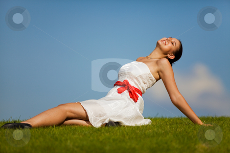 Enjoying life stock photo, Beautiful woman in a dress relaxing on a hill by Steve Mcsweeny
