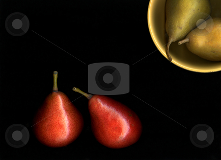 Pears and Bowl stock photo, Fresh organic pears in a kitchen bowl against a black background by Christian Slanec
