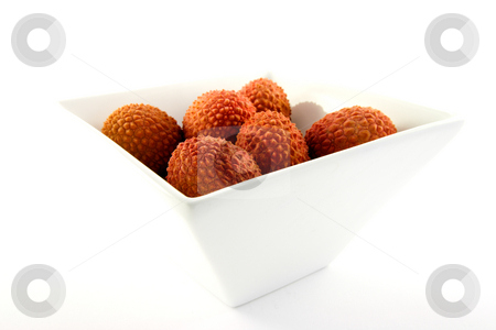 Lychee in a Dish stock photo, Group of lychee in a dish with clipping on a white background by Keith Wilson