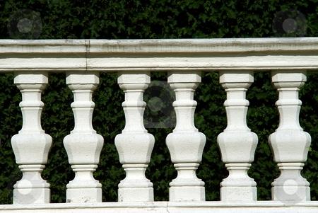 White stone fence detail stock photo, White stone fence detail with carved columns by Juraj Kovacik