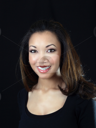 Young black woman smiling with braces on upper teeth stock photo, Young african american woman with braces on upper teeth by Jeff Cleveland