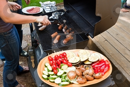 Garden grilling stock photo, Grilling is a form of cooking that involves dry radiant heat from above or below, and takes place on a grill or griddle by Mariusz Jurgielewicz