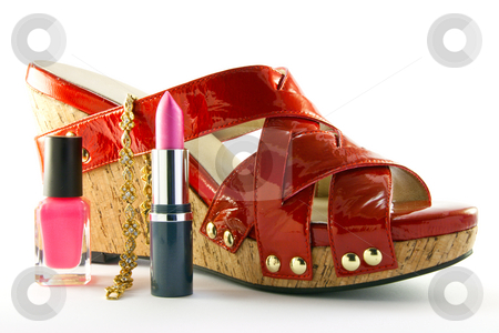 Red Shoe, Lipstick, Nail Polish and Bracelet stock photo, Single red shoe with lipstick, nail polish and gold bracelet with clipping path on a white background by Keith Wilson