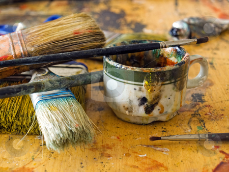 Artist's table stock photo, Closeup of  a  mess on the painter's table in some art studio. by Sinisa Botas