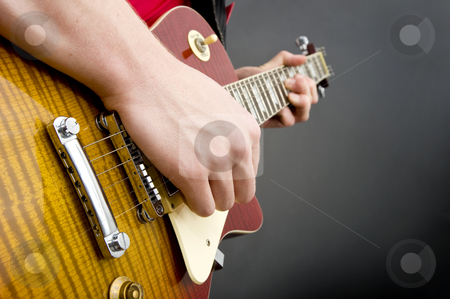 Guitar player stock photo, A man's hand striking the strings of a guitar by Corepics VOF