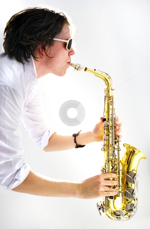 Saxophone stock photo, A high key image of a saxophone player held vertical with a strong backlit light source by Corepics VOF