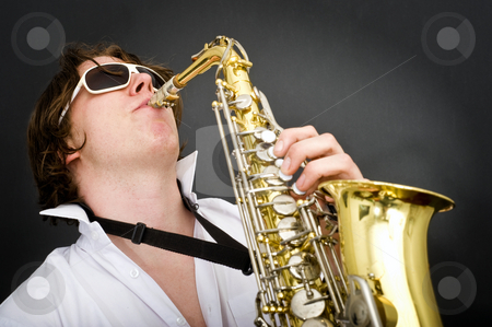 Playing the Saxophone stock photo, Striking the high note on a saxophone by Corepics VOF