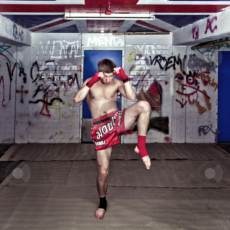 Muay Thai stock photo, A Muay Thai figher warming up in a sburban basement by Corepics VOF