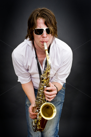 High Note stock photo, A saxophone player squeezing a high note from his instrument by Corepics VOF