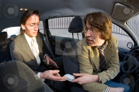 Paying the cabby stock photo, A businessman paying the fare to the taxi driver by Corepics VOF