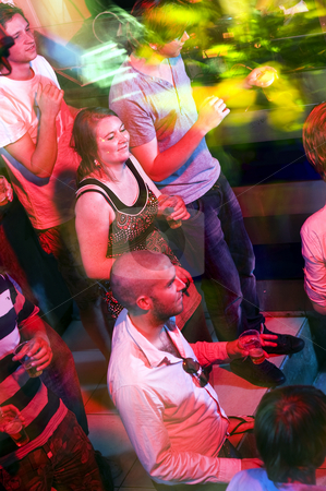 Party crowd stock photo, Party crowd on a busy dance floor, engulfed in the lights of a nightclub by Corepics VOF
