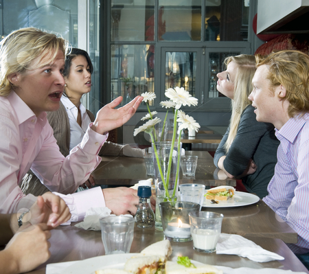 People at lunch stock photo, A group of people having lunch in a restaurant by Corepics VOF