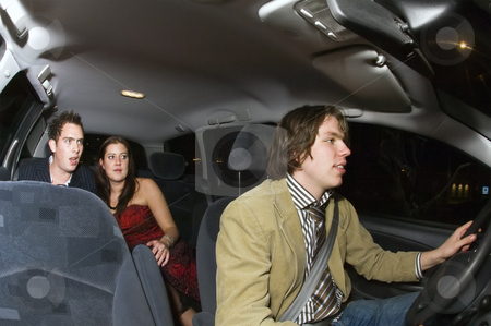 Taxi fare stock photo, A taxi driver taking a young couple home after a night out by Corepics VOF