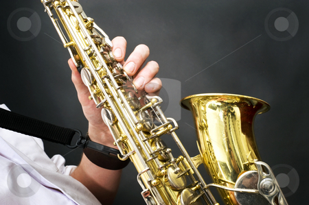 Saxophone details stock photo, Details of a shiny brass saxophone being played by Corepics VOF