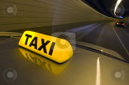 Tunnel Taxi stock photo, A taxi driving at high speed through a tunnel,  overtaking other cars by Corepics VOF