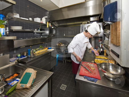 Chefs Kitchen stock photo, A chef in a profesional kitchen, preparing dinner by Corepics VOF