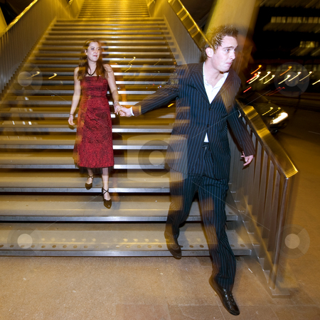 Nightlife stock photo, A couple, coming down a flight of steps after a night out in the town by Corepics VOF