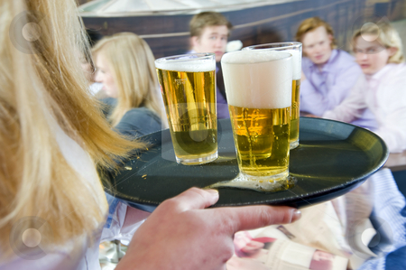 Serving beers on a tray stock photo,  by Corepics VOF